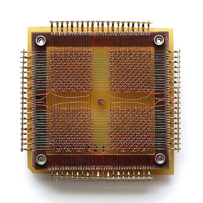 A 32 x 32 core memory plane storing 1024 bits (or 128 bytes) of data. The first core dumps were printed on paper, which sounds reasonable given these small amounts of bytes.
