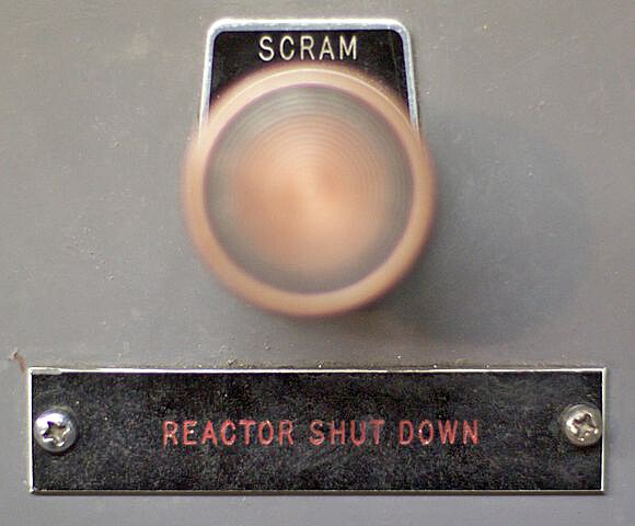 A scram switch (button), that could be pressed to prevent inadvertent operation. Maybe the TMRC had buttons labeled `foo` instead